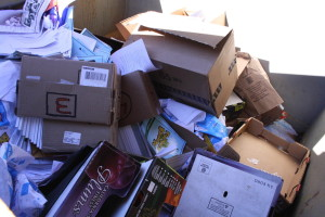 These dumpsters full of paper made products are waiting to be recycled.