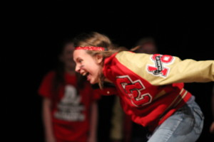 A student screams as part of her skit in the Improv Show