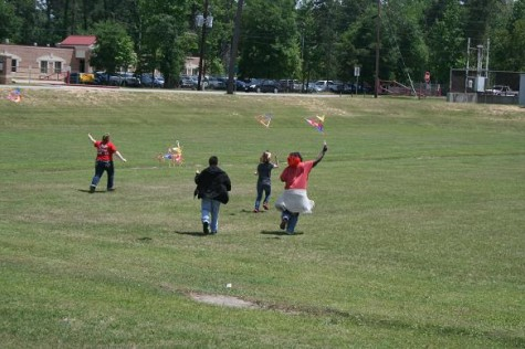 Panther Life students running with their flying kites.