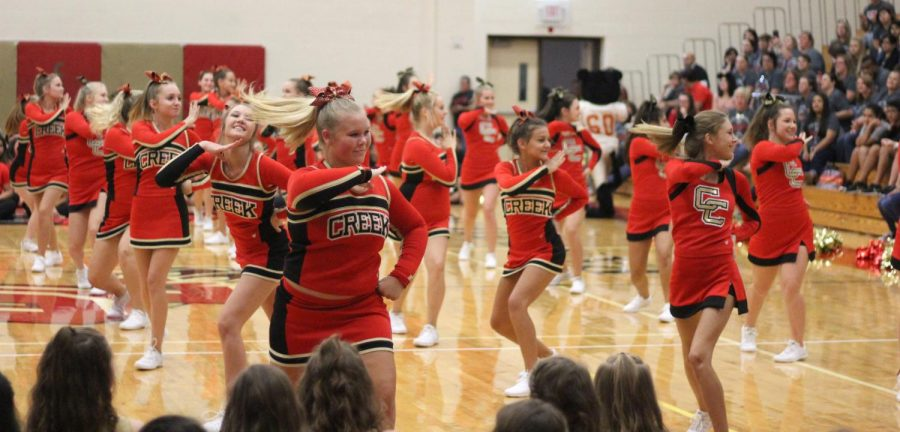 Caney Creek cheerleaders perform at the Meet the Panther pep rally. Several cheerleaders from the school squad will be traveling to New York City to participate in the Macy's Thanksgiving Day Parade.