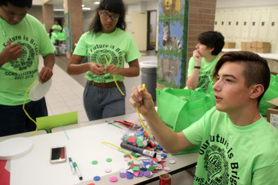 Freshman Julian Mendez, right, works with other student leaders on a project at the leadership conference.