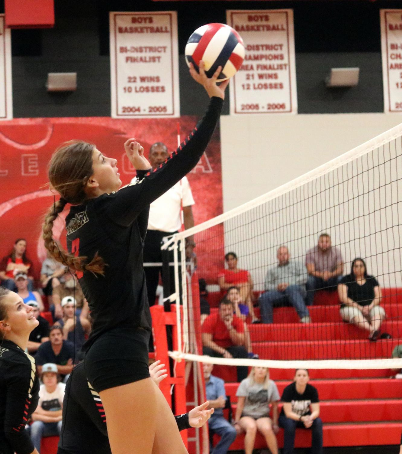 Varsity captain Blakely Niles blovks the volleyball from hitting the floor on the Panther's side of the net. Volleyball ended their season last week.