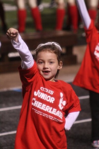 Junior Skylar Harris at a young age performing with Caney Creek High School cheerleaders at a football game.