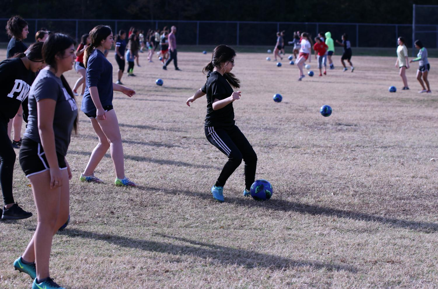 INCREASING NUMBERS. Girls tryouts had 73 players on the field. 22 players were added in comparison to last season due to coaches efforts to add in a third team.