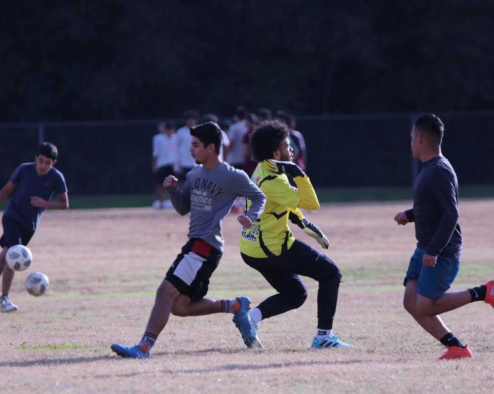 BLOCK EVERY SHOT. Junior Joao Marchese intercepts a shot during the soccer tryouts.