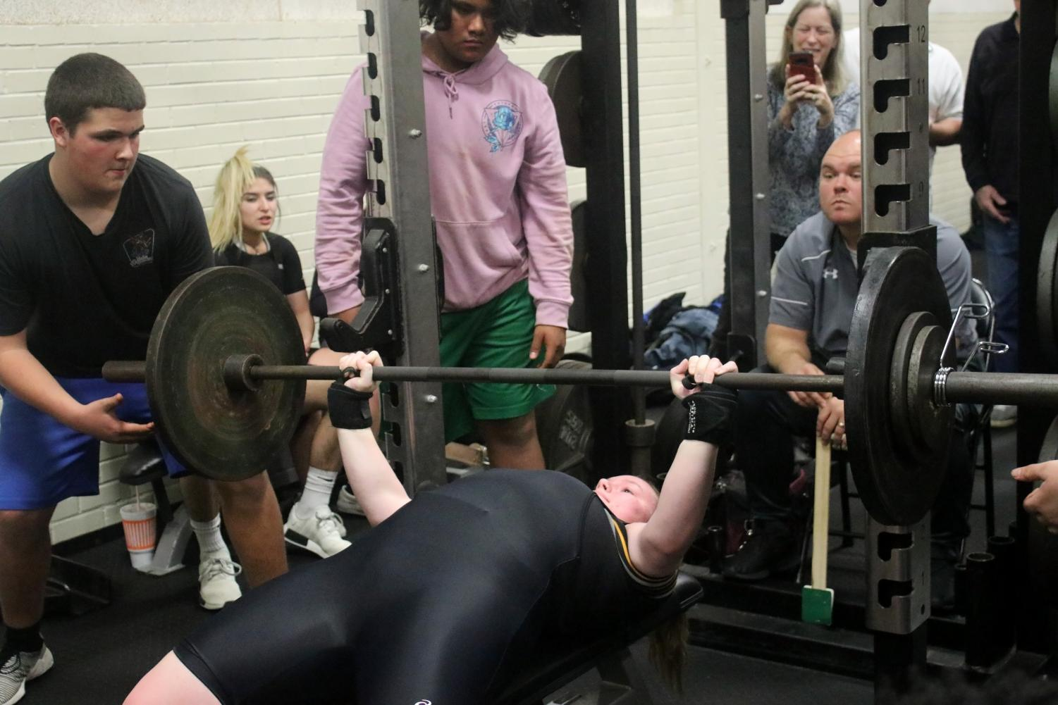 STRENGTH. Junior Realyn Peddy bench pressing 185 lbs at a quad meet held at Conroe High School Jan. 31.