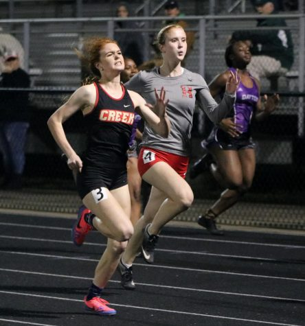 SHORT DISTANCE. Senior Anna Cox runs the 200 meter run at a meet in Hargrave High School.