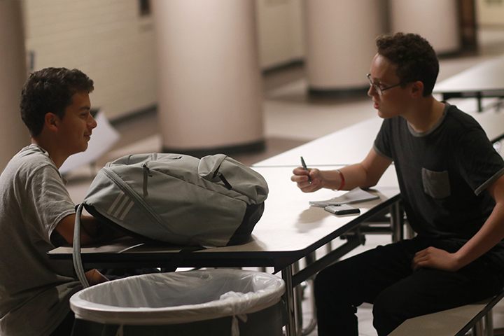 Yearbook reporter Josh Baldwin, who was also stranded at school, interviews students while they wait.