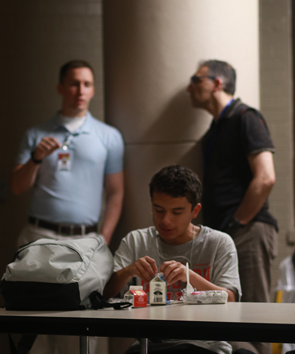Students and faculty members gathered in the small cafeteria in the morning, eating food already prepared by cafeteria workers.