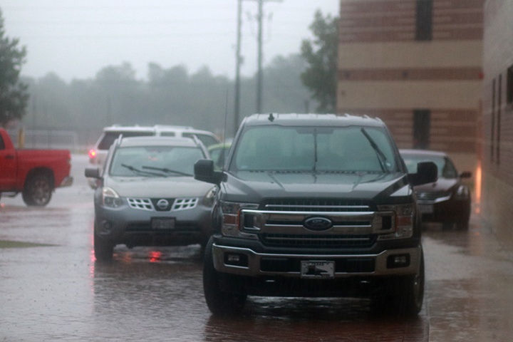 Dozens of faculty and staff members drove their vehicles up onto the sidewalk and walkways as the water continued to rise. They were forced to abandon their vehicles later in the day after a mandatory evacuation was called.