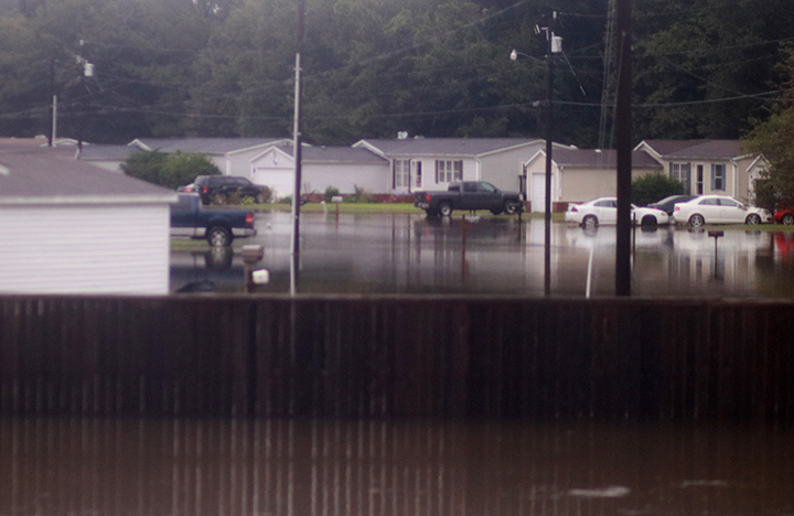 The Lone Star Ranch subdivision residents parked their car at the front entrance because the roads were completely underwater.