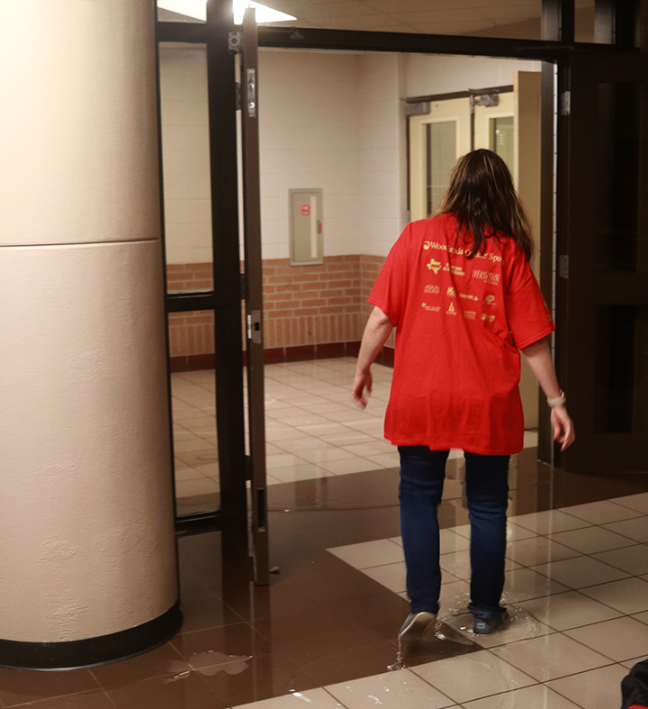 Math teacher Tricia Franchville walking to help move furniture and copier machines out of the 1100 hallway.