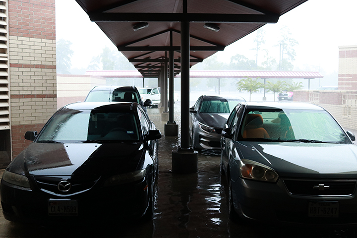 Faculty members had to drive their cars close to the bus ramp entrance as flood waters continued to rise.