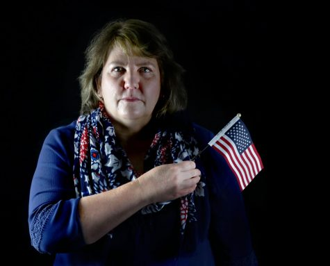 Precalculus teacher Riana Cronje stands with the same flag she received as part of her naturalization ceremony on Friday, Nov. 13. Cronje and her family moved from South Africa 15 years ago and have been going through the naturalization process for the better part of a decade.