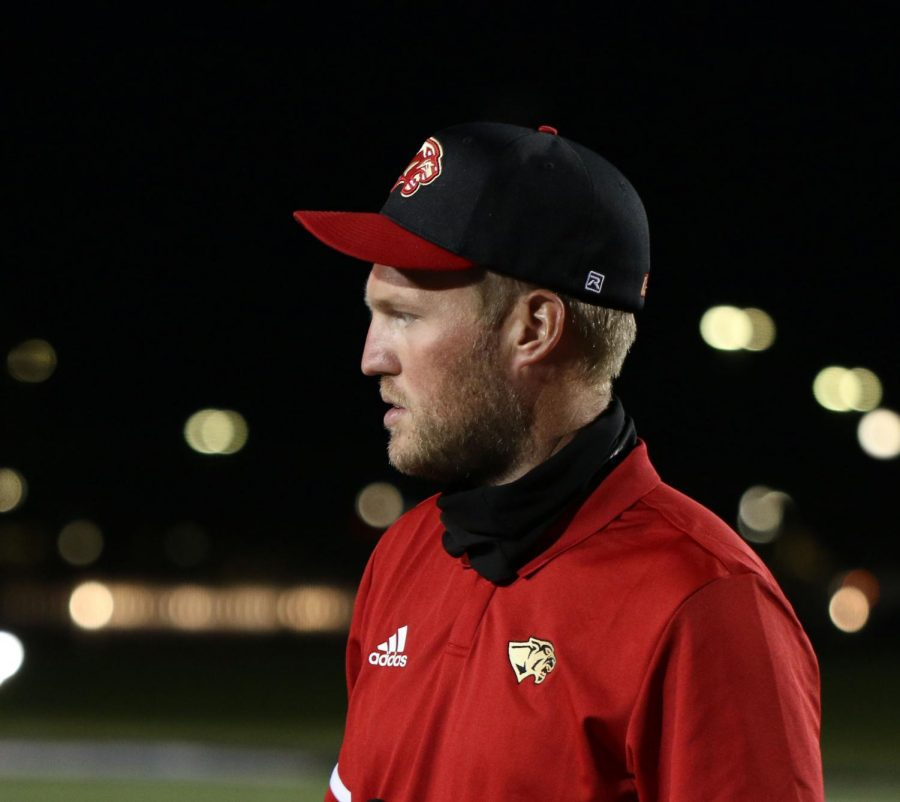 NEW+MAN+IN+TOWN.+Head+coach+Kendall+Hineman+at+the+Porter+football+game+Thursday%2C+Nov.+5.+He+has+focused+on+building+culture+and+environment+in+his+first+year+to+set+the+teams+up+for+success+in+future+years.