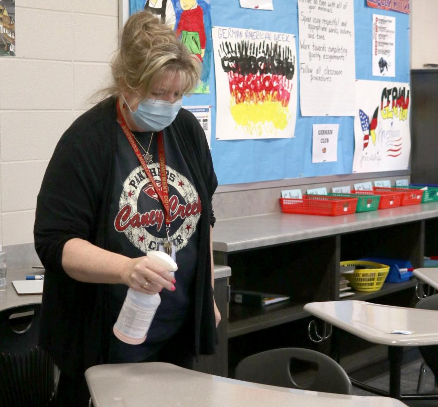 German teacher Trina Powers sprays down her classroom Oct. 29 with Quat 256, a chemical that kills Covid-19 in roughly a minute.