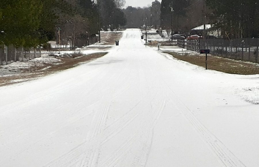 Pinewood Village Drive and every road in Montgomery County received inches of ice and snow in a winter storm Monday, Feb. 15.
