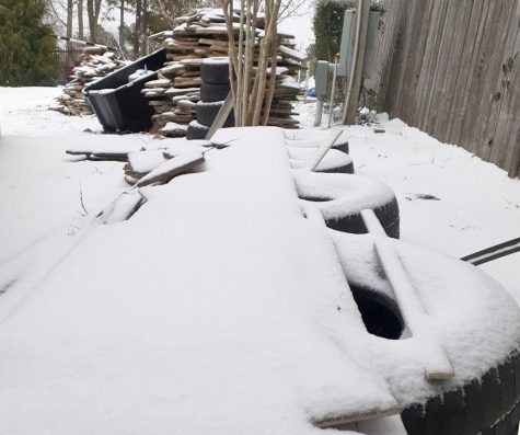 Snow covers a pile of construction materials Monday, Feb. 15 after a winter storm blanketed Montgomery County in ice and snow.