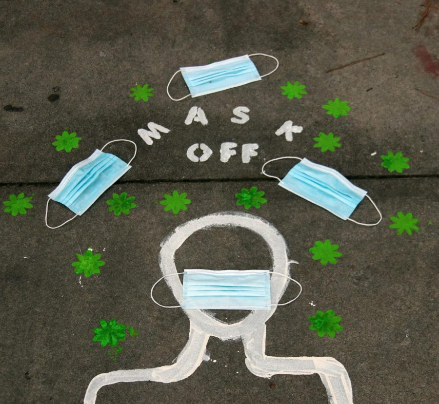A chalk drawing made by CCHS student media on July 28 which depicts a person wearing a mask.