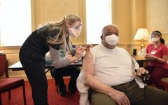 Photo used with permission from Maryland GovPics from flicker   Nurse gives patient Covid-19 vaccine.