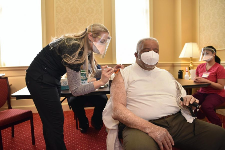 Photo used with permission from Maryland GovPics from flicker|  Nurse gives patient Covid-19 vaccine.