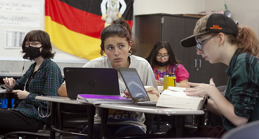German students Alexa Mercado, Kyleigh Clark, Victoria Famer, and Leah Wallace, working on their assignment using the resources provided. When Wallace was asked about why she chose to wear her mask she said I chose to wear my mask because  I do have high risk family members, and I would like to protect them and myself and other people.